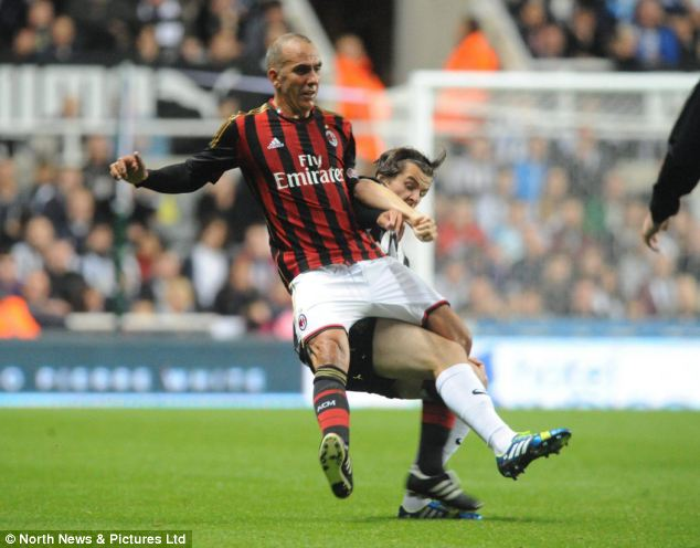 Crunch: Joey Barton goes in hard on Di Canio from behind