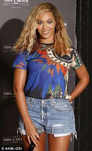 """Beyonce arrives at the press conference for her """"Mrs. Carter Tour"""" in Brazil and was all smiles as she posed for the cameras"""
