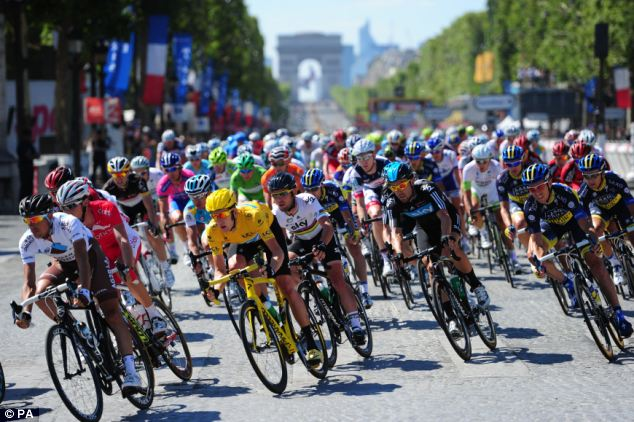 Leader: Wiggins (yellow jersey) on his way to winning the 2012 Tour de France