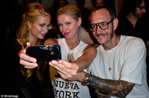 Say cheese: Paris and Nicky snapped photos from the front row with their photographer pal Terry Richardson