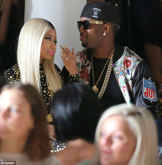A couple of fashion fans: Nicki brought her boyfriend Safaree Samuels along to sit front row with her