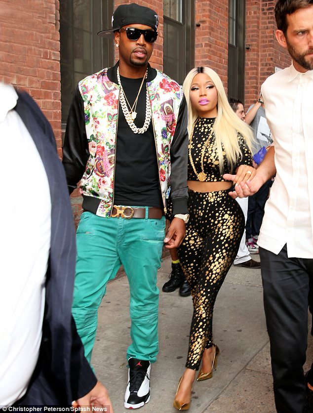Bodacious: The singer was sported a black and gold crop top and leggings which clung to her every curve