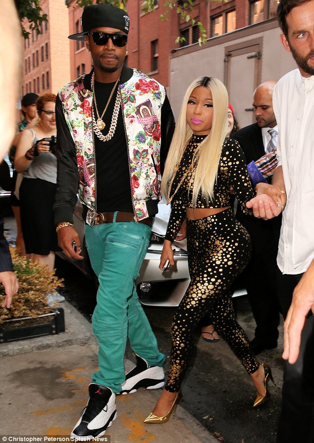 Breaking the rules: It is custom to wear a designer's collection to their show but Nicki Minaj sported her own design to Jeremy Scott's New York Fashion Week show on Wednesday