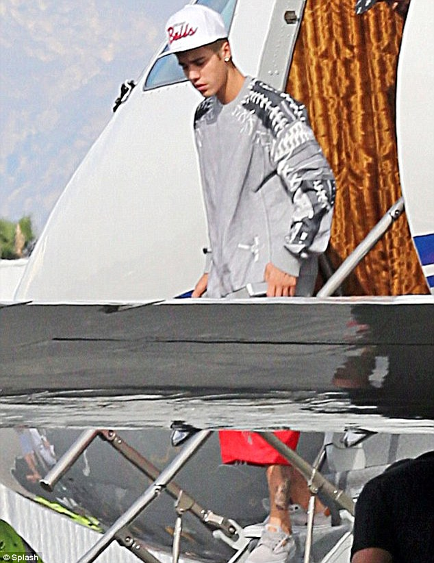 'I almost had to put an oxygen mask on!' Justin Bieber (pictured on a private jet earlier this month) has been accused of being 'baked out of his mind' for a recent private flight by the pilot who flew him