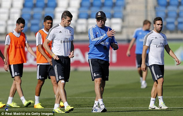 Man in charge: Bale speaking to his new Real Madrid boss Carlo Ancelotti