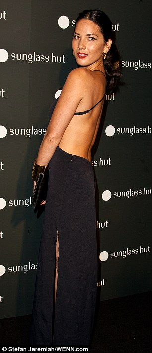 Olivia Munn attends the grand opening of a new Sunglass Hut store on new York's Times Square on Tuesday