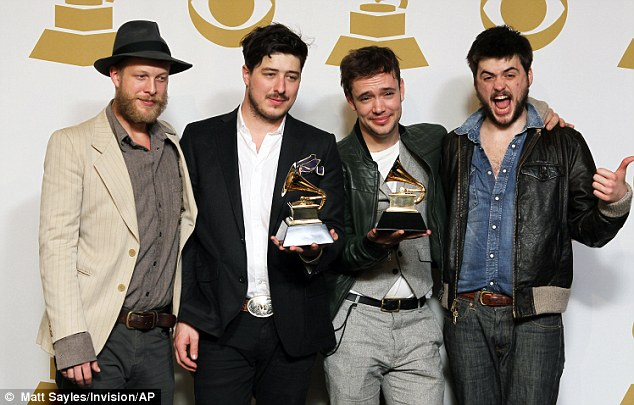 The band pose with their Grammy Awards in 2011