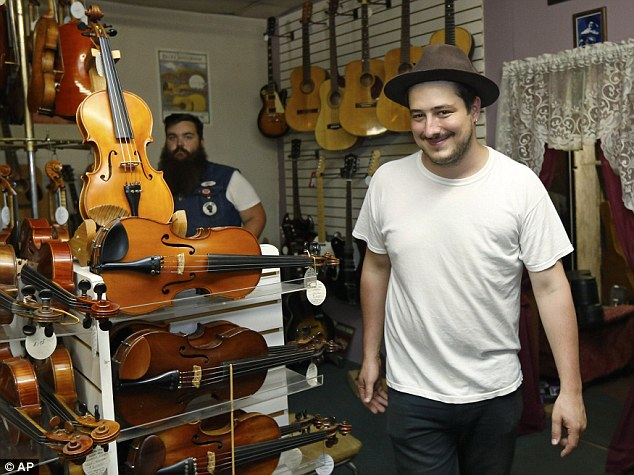 Out and about: Marcus Mumford visits a fiddle shop in Oklahoma. The band have previously opened up about their fondness for the US