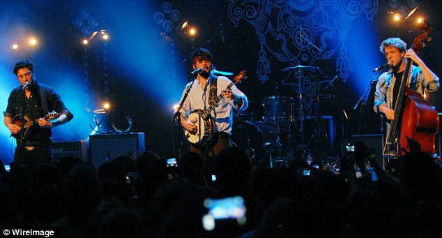 """Marcus Mumford, """"Country"""" Winston Marshall and Ted Dwayne of Mumford & Sons perform at the Buckhead Theatre in Atlanta in 2010"""