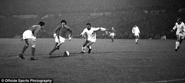 Genius: Best (second right) takes the ball past the Benfica defence in 1966