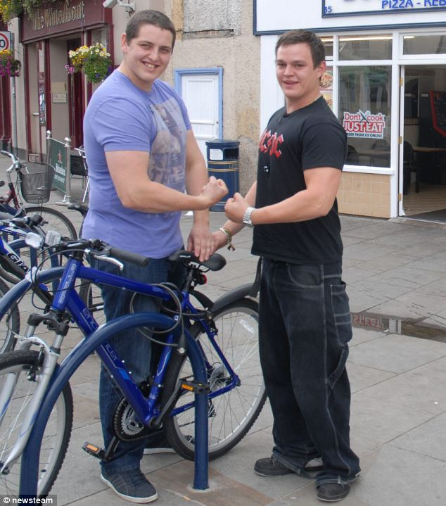 Dean Mason (left) and Martin Griggs (right) pictured by the bike rack after they bent it back into shape on a night out