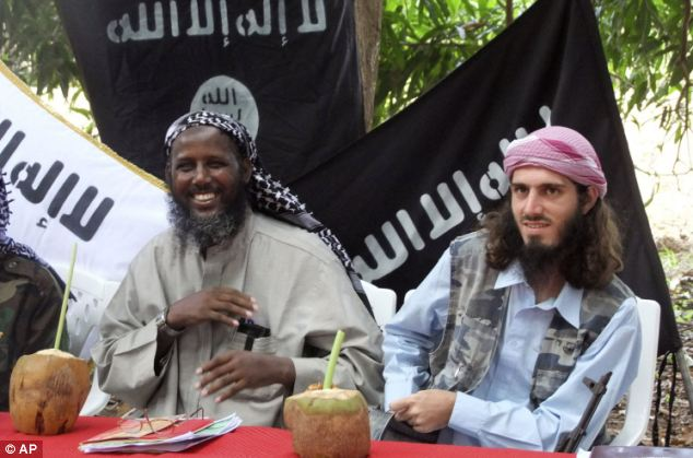 Killed: Hammami, right, joined al-Shabab in 2006. He is pictured with deputy leader of al-Shabab. Sheik Mukhtar Abu Mansur Robow, left, in 2011 but he went on the run after falling out with the group