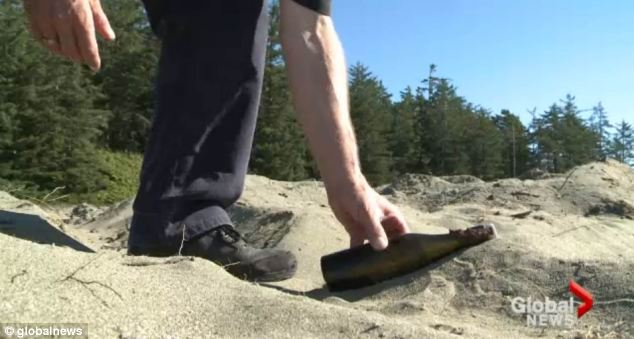 The 107-year-old bottle was nestled in the sand of Schooner's Cove in Tofino, Canada