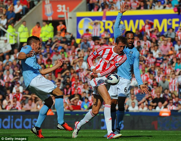 Handy work: Last season's clash at the Britannia Stadium saw Peter Crouch (centre) open the scoring for Stoke before Javi Garcia later grabbed an equaliser for City