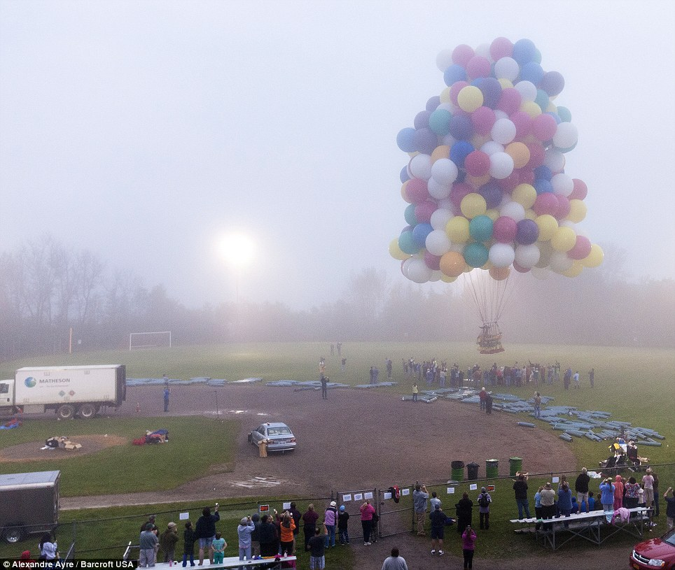 We have lift off! Jonathan Trappe takes to the air on a cluster of balloons in a bid to become the first man to successfully cross the Atlantic Ocean in such a way