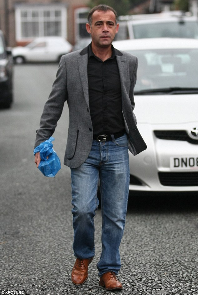 Freshened up: Michael Le Vell looks smart as he leaves his house on Thursday, reportedly to go and speak to Coronation Street bosses about his imminent return to the Cobbles
