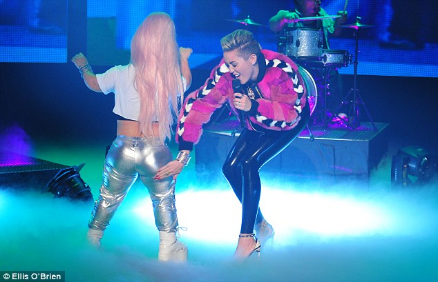 Upping her game: During her performance Miley smacked one of her dancers on the bottom