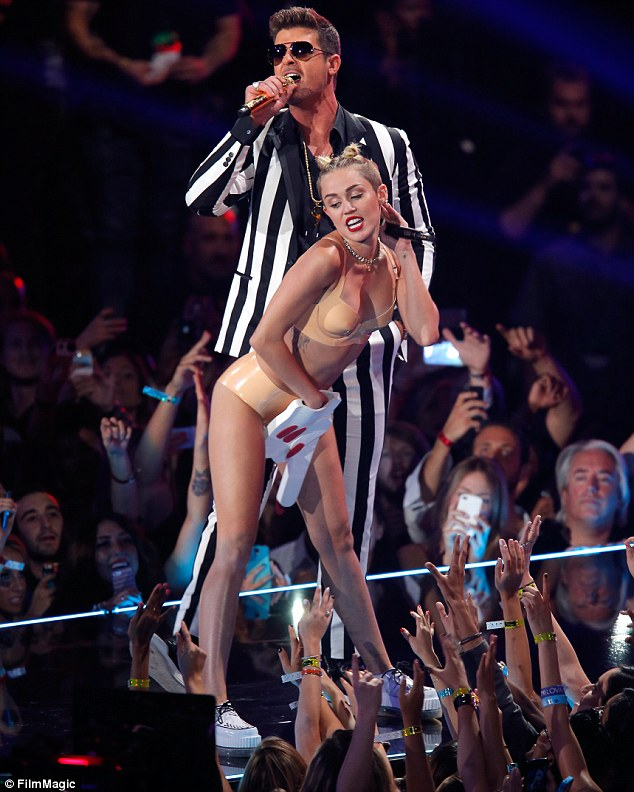 Recreation: Miley was happy to use a foam finger again as she did in her famous VMAs performance