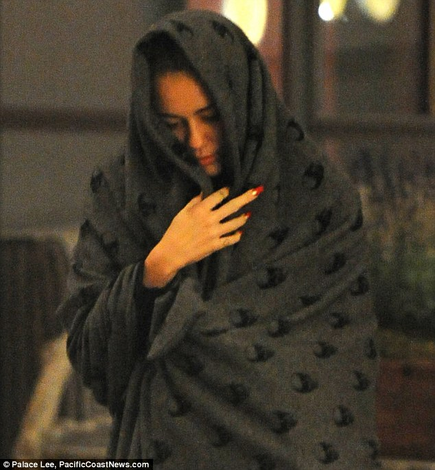 Deep in thought: Miley seemed to be thinking about something as she left avoiding her fans