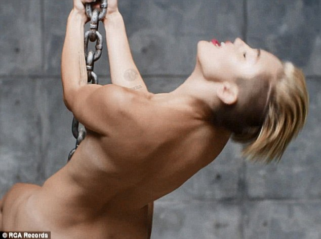 Raunchy: This week Miley also released the video for her new single Wrecking Ball