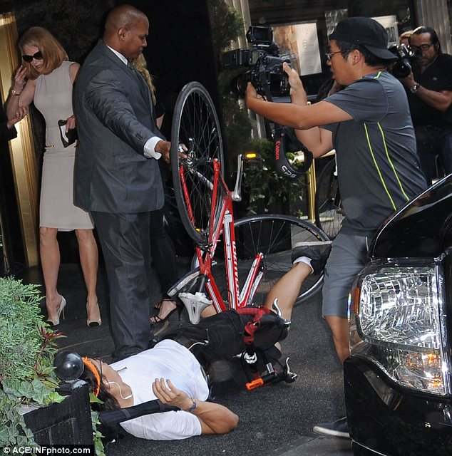 Exit stage right: Other photographers were taking pictures at the scene so a man ushered Nicole into the hotel