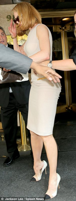 Always graceful: Nicole attempted to slip back into her high heels but then realised it was better to leave it