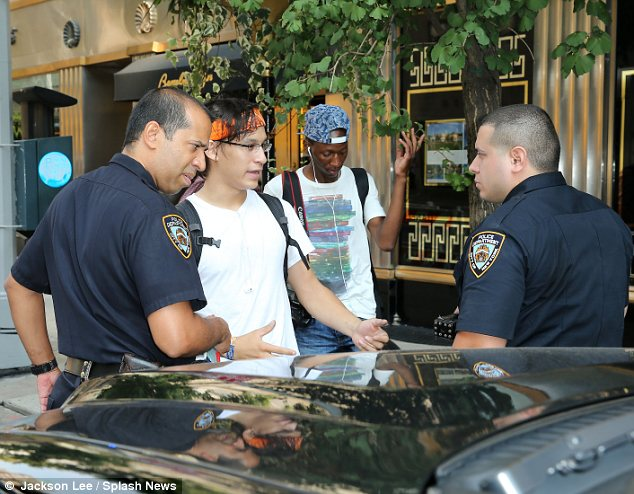 Questioned: Wu was seen talking to the police who most likely gave him a ticket for cycling on the sidewalk