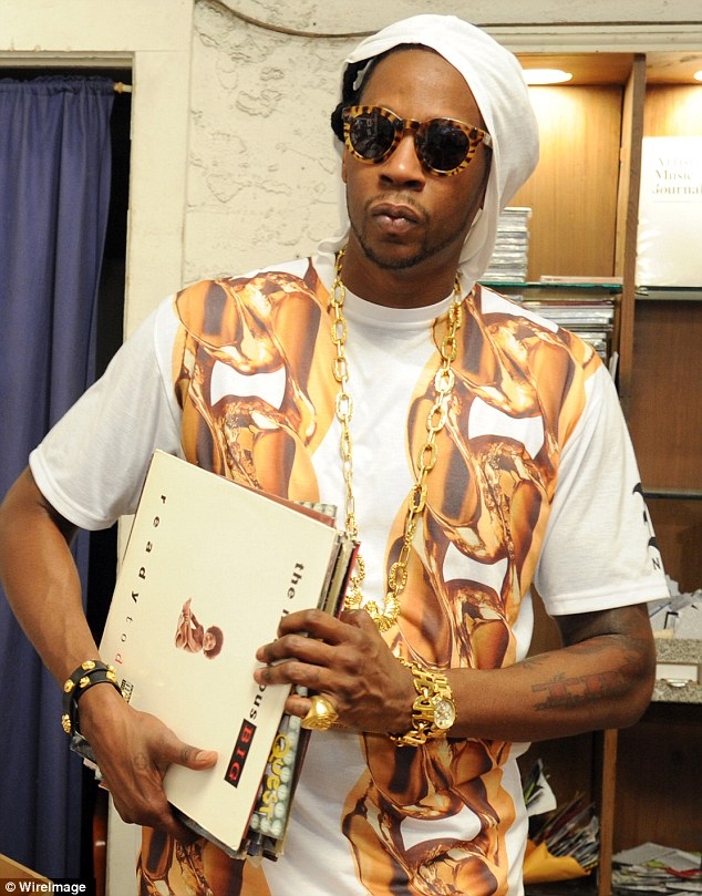 Flamboyant: 2 Chainz wore several pieces of heavy gold jewelry on the day - a chain (of course), a watch, some bracelets and a massive ring