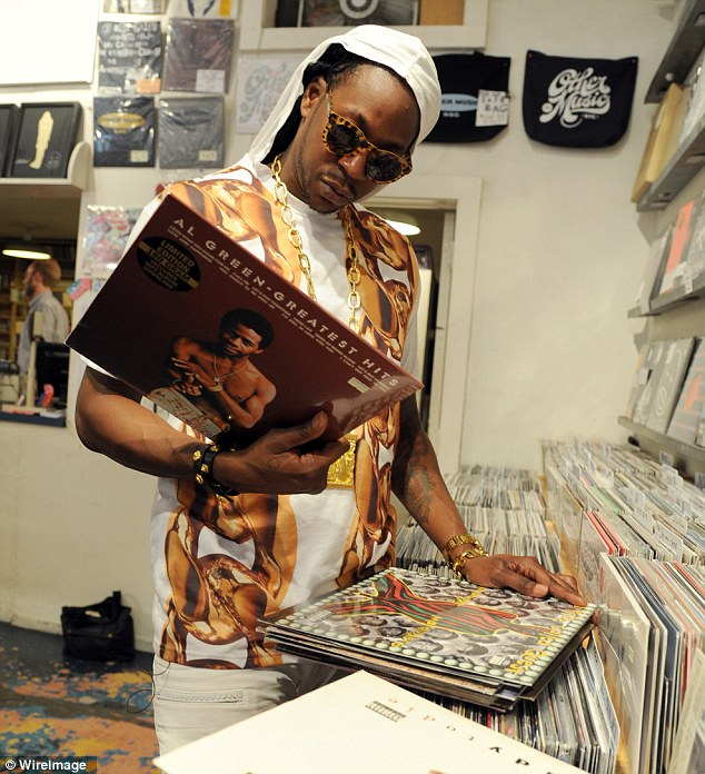 Back to the roots: 2 Chainz peruses some Al Green records at Other Music