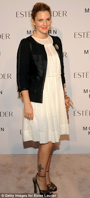 Radiant: Drew Barrymore was positively glowing as she attended Estee Lauder's launch party for their fragrance Modern Muse at the Guggenheim Museum in New York City on Thursday