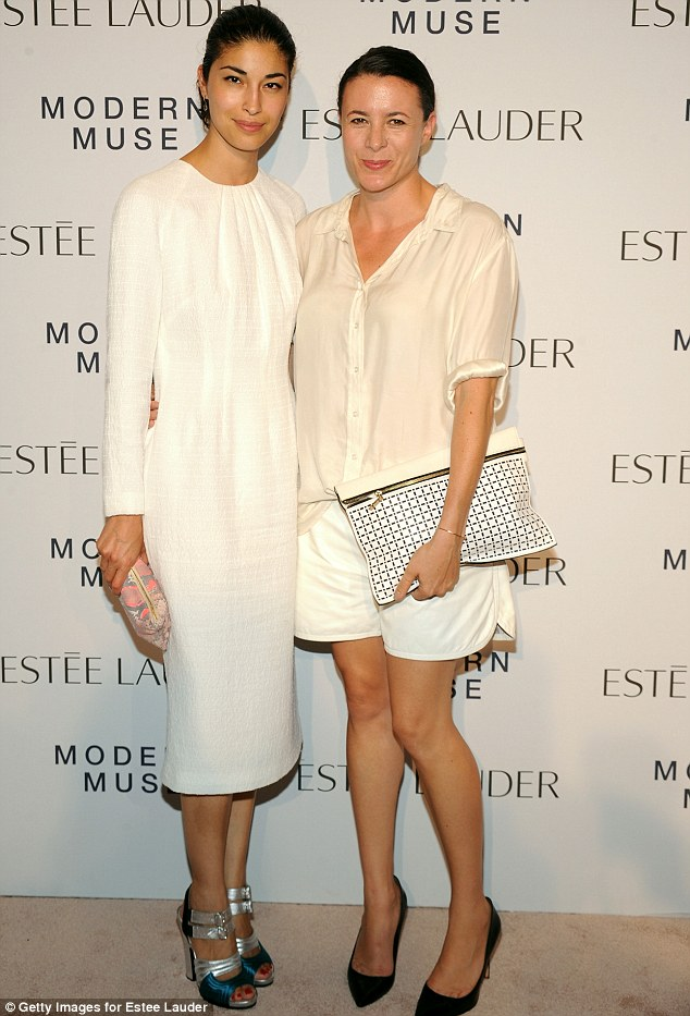 White night: Caroline Issa (L) and Garance Dore wore chic and light ensembles to the Estee Lauder party