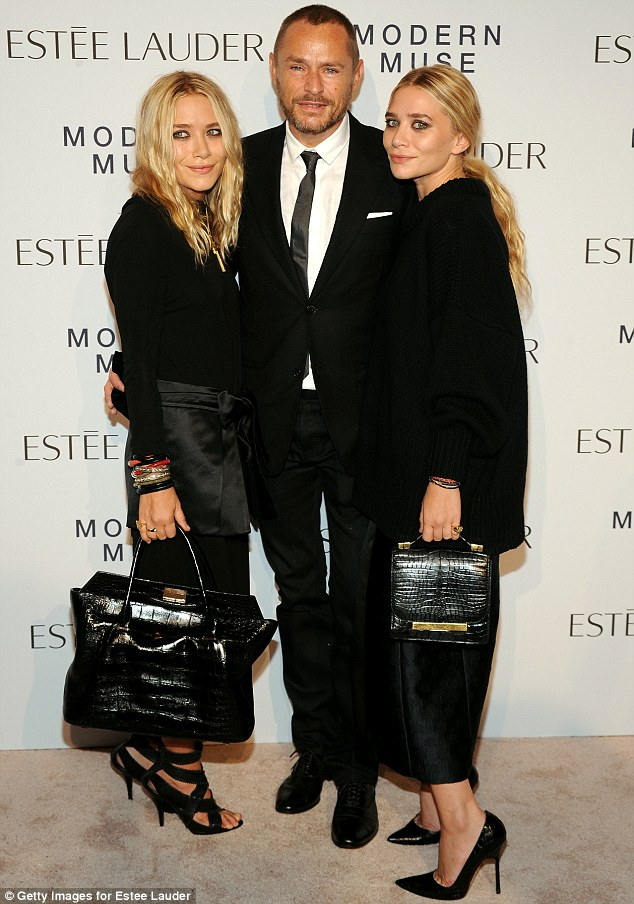 Sisters: Mary-Kate and Ashley Olsen stood either side of makeup artist Tom Pecheux in all-black ensembles