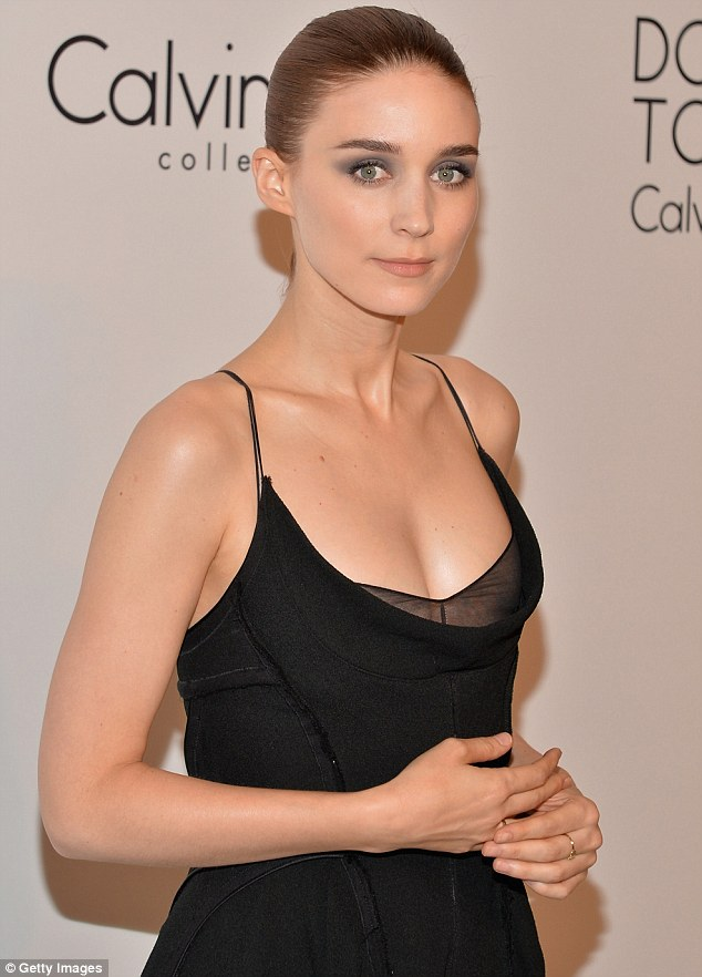 Girl on fire: Rooney Mara looked beautiful in an understated black gown at the party