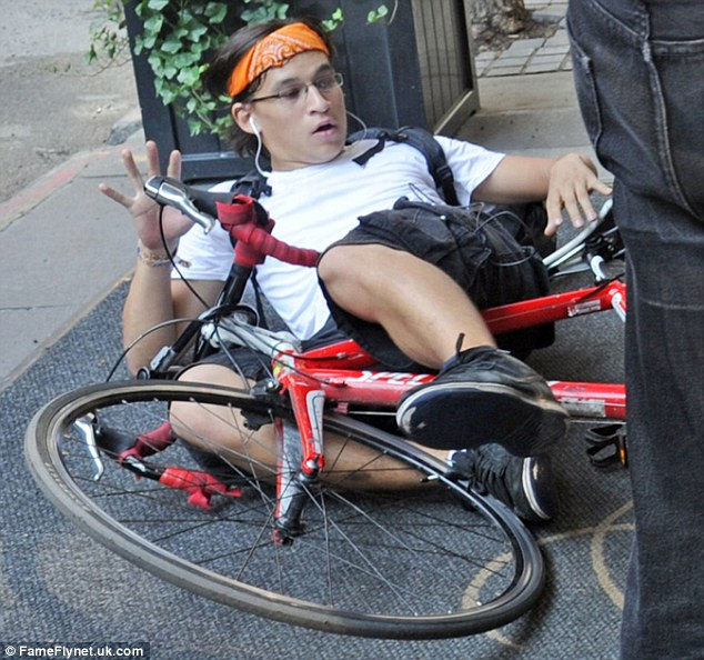 Crash landing: Celebrity photographer Carl took a spill on his bike after slamming into Nicole