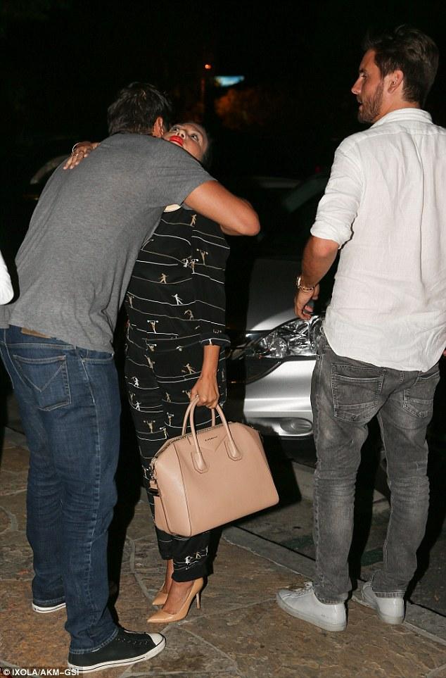 Saying goodbye: Joe, a long-time family friend of the Kardashians, leaned down for a hug from the diminutive Kourtney