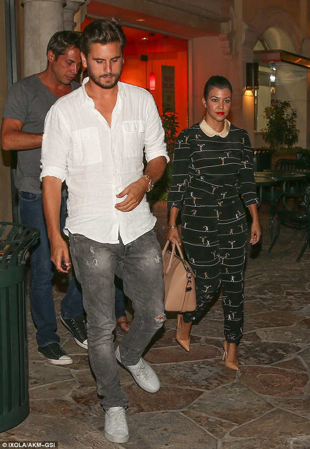Mismatched: Scott swapped his usual dapper look for a pair of tired looking jeans and scruffy trainers whilst Kourtney dressed up