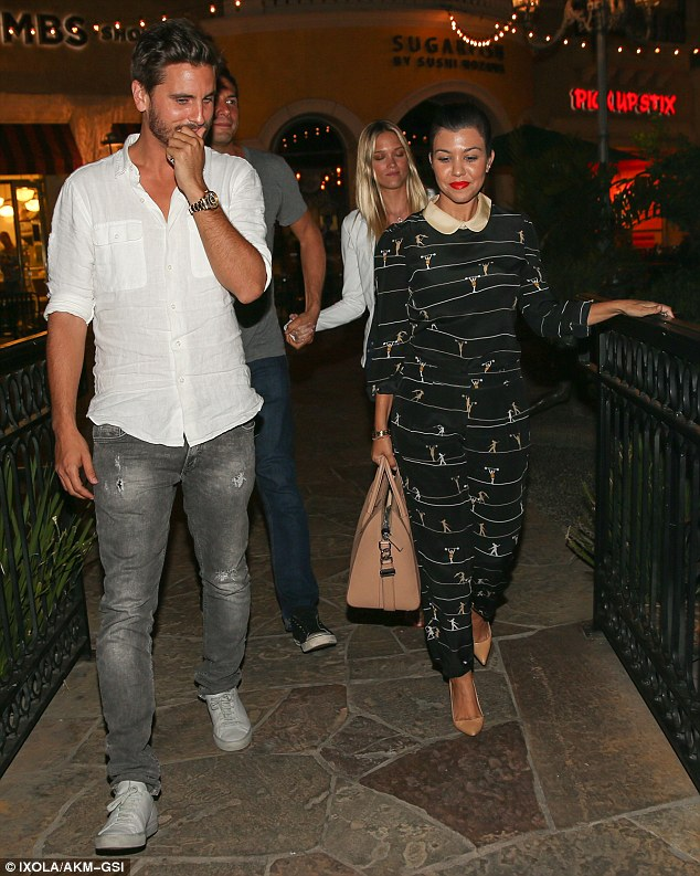 Double date: Kourtney and Scott were joined by Girls Gone Wild creator Joe Francis and his girlfriend Abbey Wilson at SugarFish in Calabasas