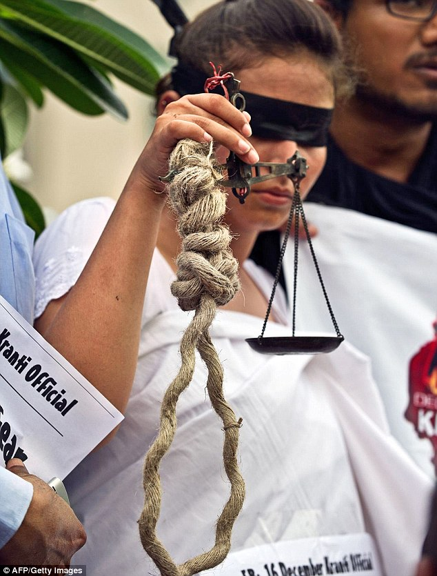 Noose: An Indian woman protestor demands the death penalty outside the court yesterday