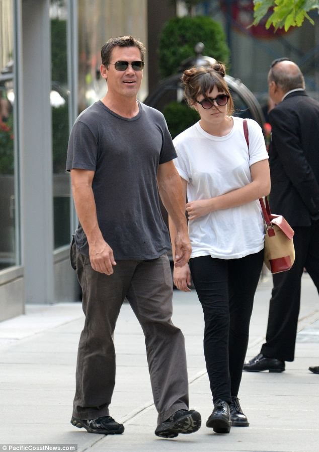 Laidback style: the 45-year-old star was casually dressed in a dark grey T-shirt with light grey trousers while his daughter wore a pair of leggings and a white T-Shirt