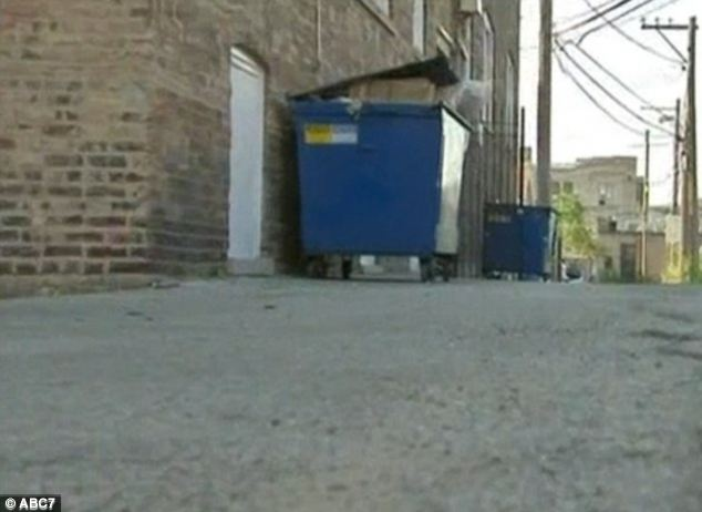 Crime scene: The teenagers targeted Mr Mora in an alley in the West Rogers Park neighbourhood in Chicago, where he had been collecting soda cans