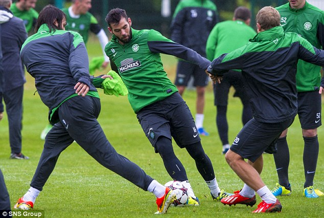 Celtic ace Joe Ledley (centre) gets on the ball during training.