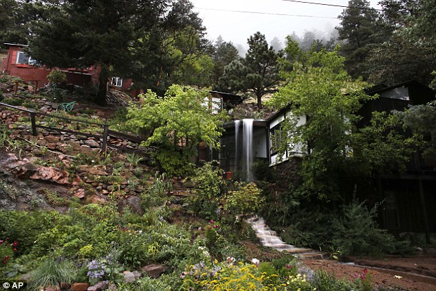 Stream: Water spills over a hillside home at the base of Boulder Canyon today