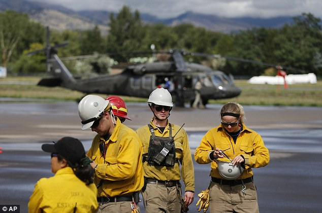 Up in the air: A Rocky Mountain Rescue Team prepares to depart in a National Guard piloted helicopter