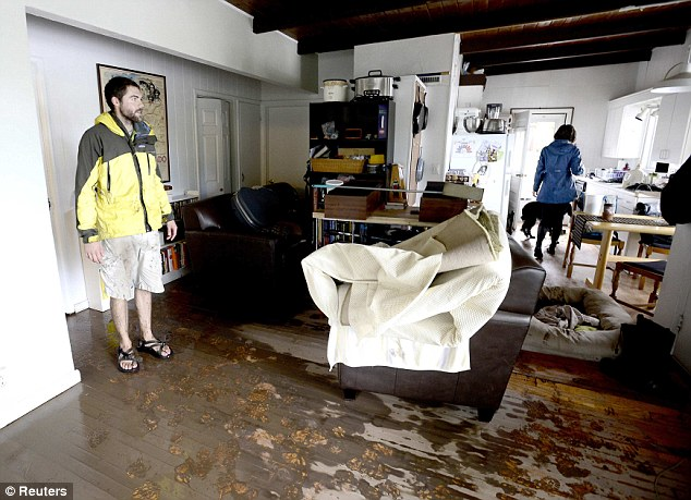 Home invasion: A couple returns to find their home Friday to find it water-damaged from the previous days floods