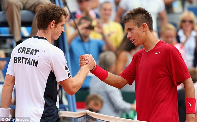 Job done: Andy Murray beat Borna Coric in straight sets as Great Britain took an early lead against Croatia