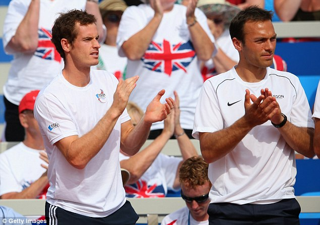 Supporting cast: Murray watches on as Dan Evans (below) suffers defeat to Ivan Dodig to level the tie in Croatia