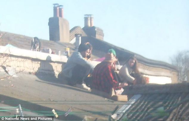 Neighbours say the squatters sit on the roof and make noise, making their lives a misery