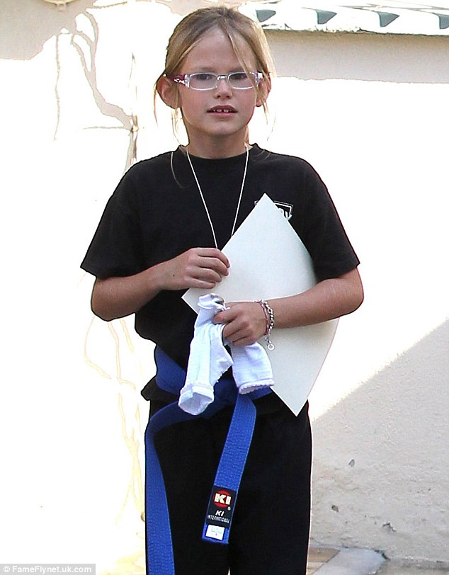 Working her way up! Violet showed off her blue karate belt that she's earned over time