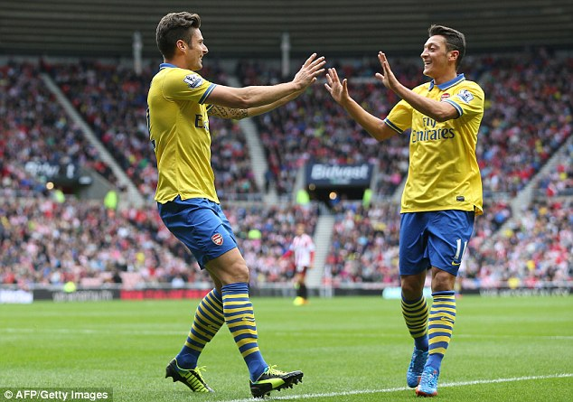 Strong start: German midfielder Mesut Ozil (right) set up Giroud as he made his debut for Arsenal