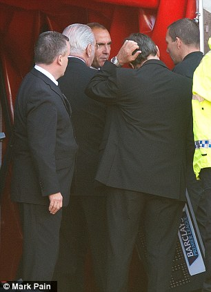 Bad day at the office: Sunderland boss Paolo Di Canio sits on the hoarding after being sent from the dugout